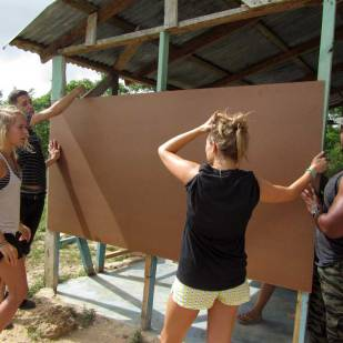 Students installing the board
